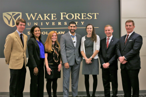 Clinic students and director pictured with Medal of Honor recipient Florent Groberg